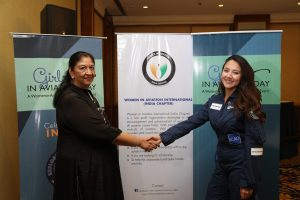 Radha Bhatia, President WAI(India Chapter) shaking hands with Afghani-American woman pilot Shaista Waiz in Mumbai. She welcomed Shaesta Waiz to promote STEM curriculum in India & to encourage the next generation to take aviation as a preferred career.