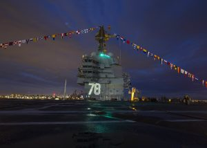 US Navy's to be commissioned aircraft carrier USS Gerald R Ford all lit up and decorated at its pre-commissioning during the US Independence Day on 4th July.The ship will get commissioned on July22 2017 at Naval Station Norfolk. This ship has advances in technology such as a new reactor plant, propulsion system, electric plant, Electromagnetic Aircraft Launch System (EMALS), Advanced Arresting Gear (AAG), machinery control, Dual Band Radar and integrated warfare systems.