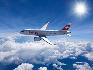 Swiss Airways owned CS100 flying on its first flight commercially from Zurich to London. It is flying above the clouds.