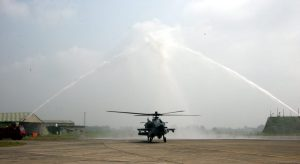 Apache getting the traditional water canon welcome before induction into IAF